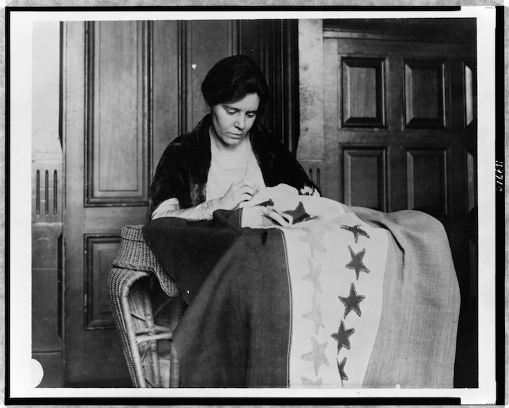Photo from http://loc.gov. Alice Paul sewing the suffragette flag, sometime between 1912 and 1920.