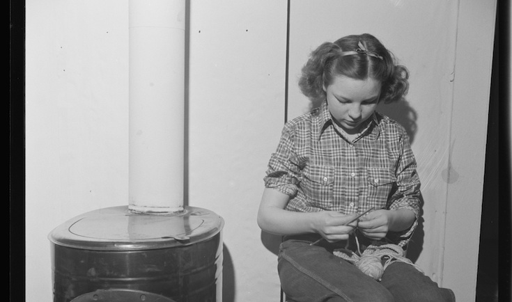 Photo from http://loc.gov: Moreno Valley, Colfax County, New Mexico. A rancher's daughter knitting during a poker party at George Turner's ranch. (Minus the stove, this is pretty much what I looked like on my couch.)