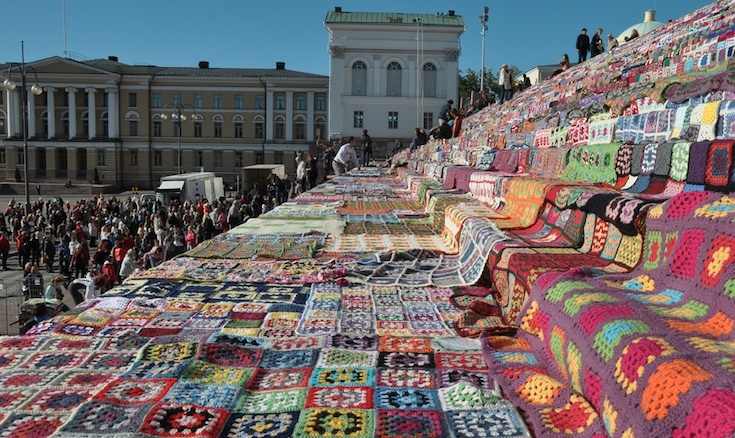 Just some of the 7,800 crochet quilts laid on the steps of the Helsinki Cathedral by Flickr user timelessriver.