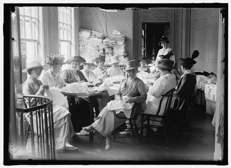 Photo from http://loc.gov, by Harris & Ewing in 1915.  Senate Women Sewing at District Headquarters, Red Cross